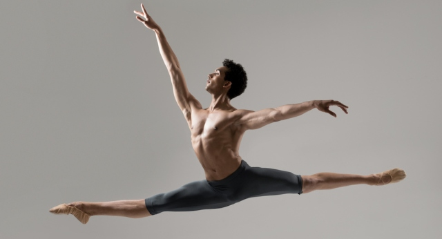 Male dancer photographed jumping in the studio